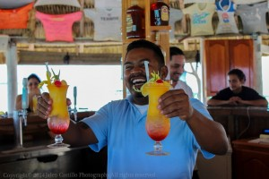 Our bartender serving two Belize All Inclusive Tropical Drinks