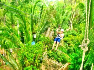 Zipline through the Belize jungle with our All Inclusive Vacation Package