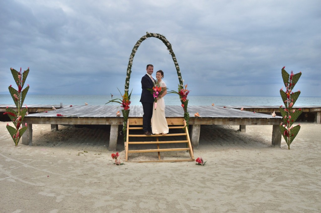 The bride and groom on their wedding day at an all inclusive private island
