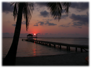 Sunrise over the dock of Coco Plum Island Resort