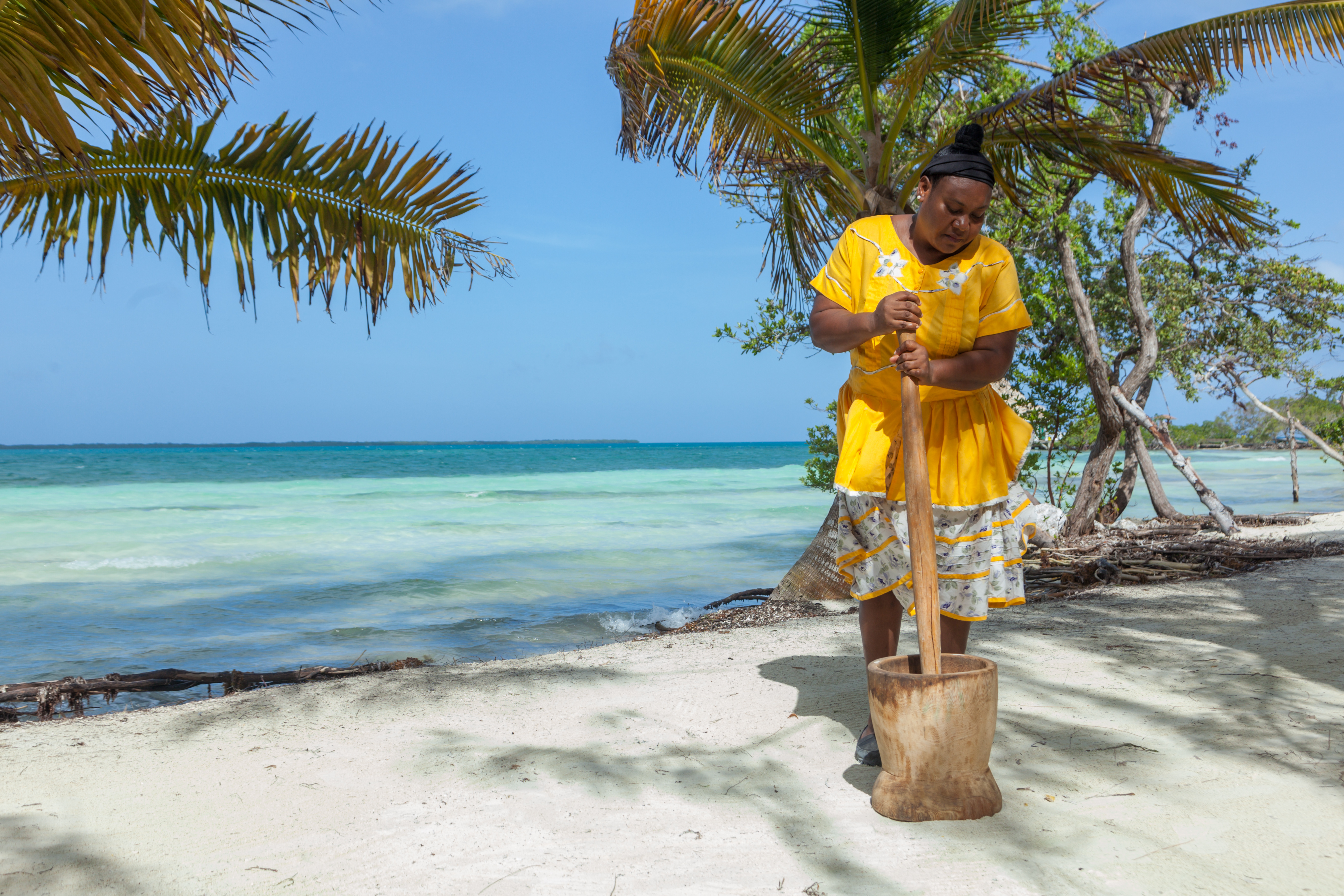 Ms. Jude cooking a traditional Garifuna meal, Hudut at Coco Plum Island Resort