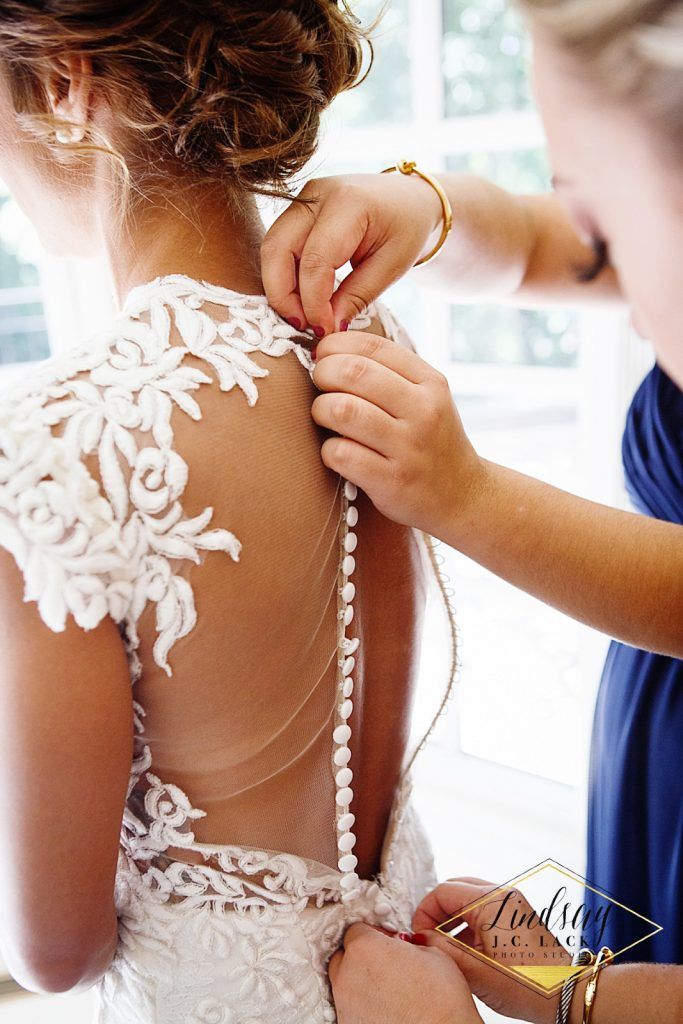 Dressing Ashley for wedding ceremony