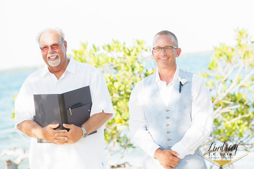 Officiant and groom during a Belize destination wedding at Coco Plum Island Resort