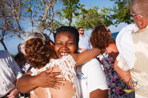 Coco Plum Island Wedding - Staff hugs